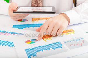 depositphotos_14167168-stock-photo-businessman-analyzing-graphs-and-charts